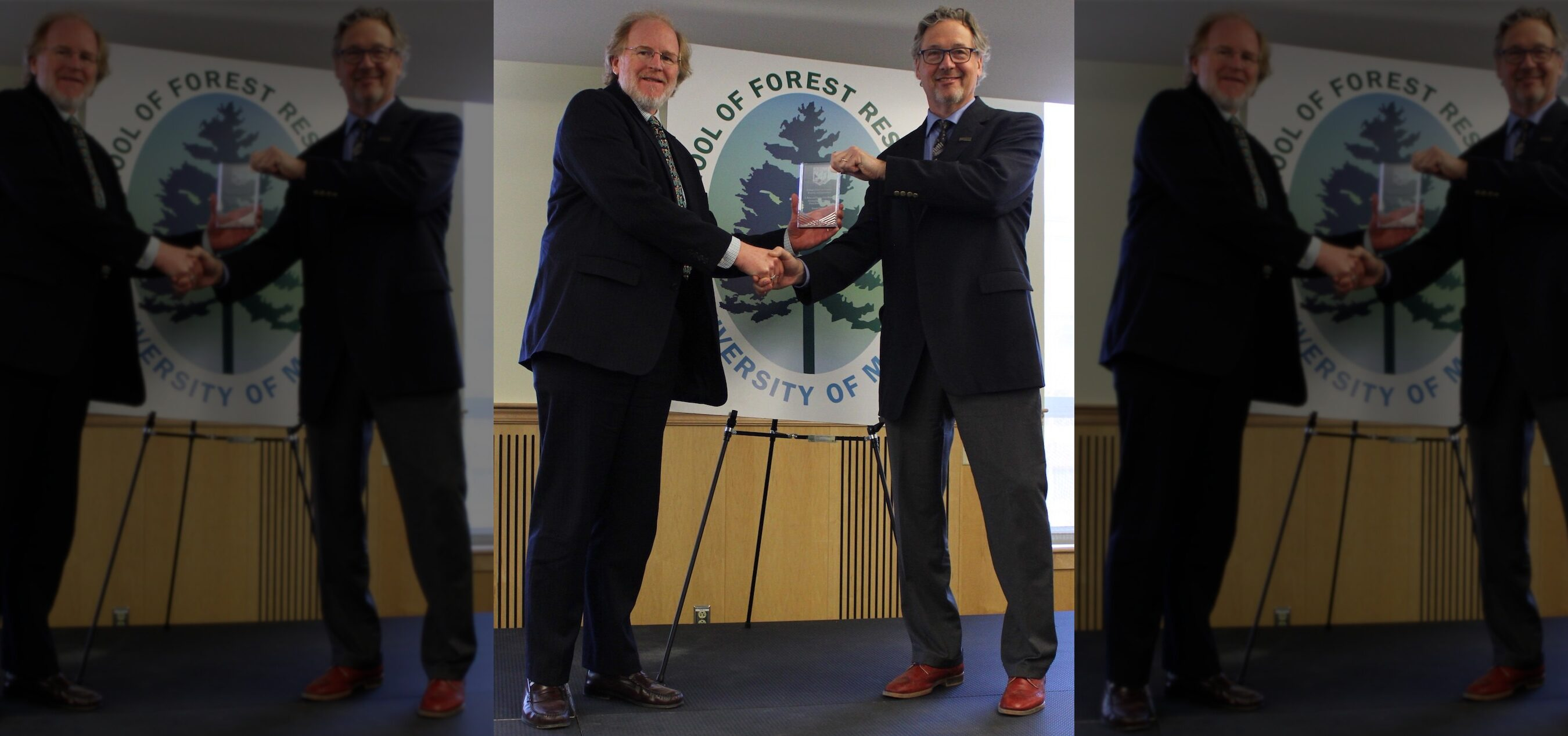 Dr. Gardner Receiving Award