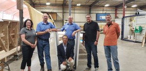 Dr. Dagher (kneeling) and Dr. Davids (far right) with team members from AIT Bridges and the innovative, rapidly deployable composite bridge girder designed at the ASCC.
