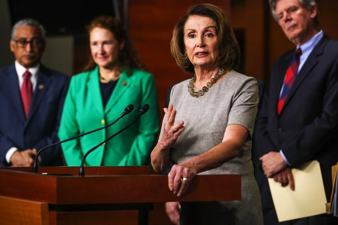 House Minority Leader Nancy Pelosi talks to reporters while announcing the House Democrats' new infrastructure plan during a news conference on Thursday in Washington.