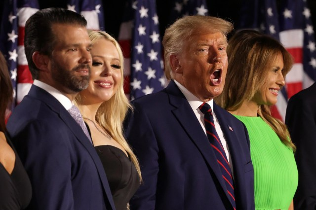 Donald Trump stands mouth open with Melania, Don, Jr., and Tiffany Trump.