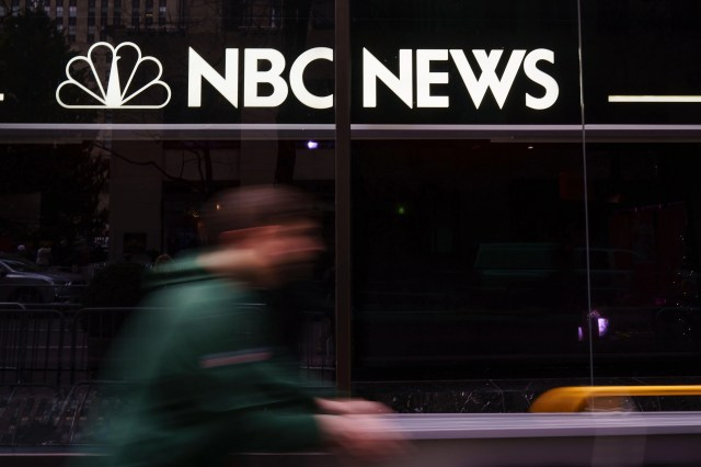 A pedestrian walks past the NBC News studios, Nov. 29, 2017 in New York City.