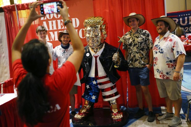 People take a photo with the statue of former President Donald Trump on display at the Conservative Political Action Conference held at the Hyatt Regency on February 27, 2021 in Orlando, Florida.