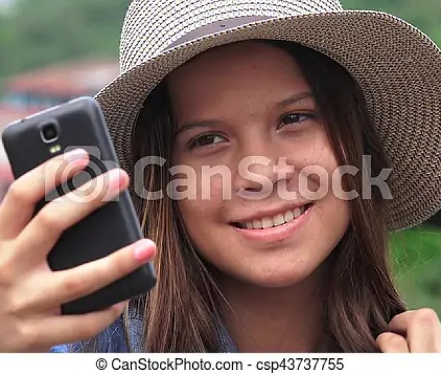 Adorable Teen Girl Making Selfies Csp43737755