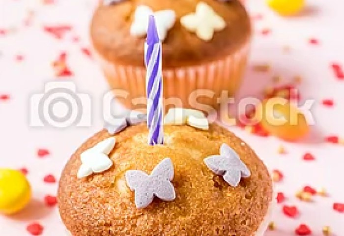 Birthday Cupcakes With Candles On The Table Pink Background