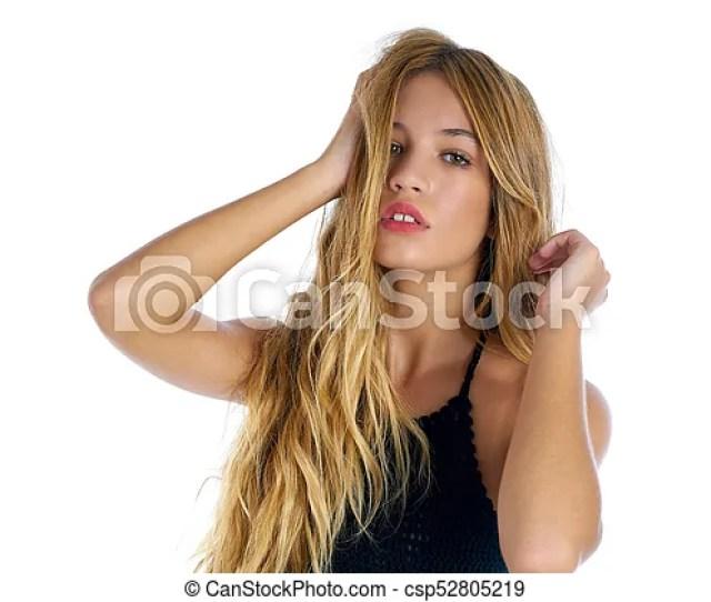 Blond Teenager Girl Touching Hair On White