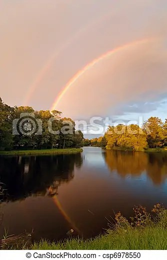 rainbow over autumn pond - csp6978550