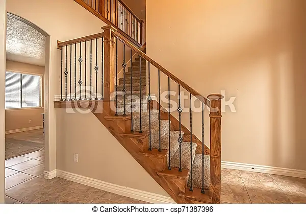 Carpeted Stairs With Wood Handrail And Metal Railing Inside An | Wall To Floor Handrail | Glass | Paint Colors | Staircase | Wrought Iron | Concrete
