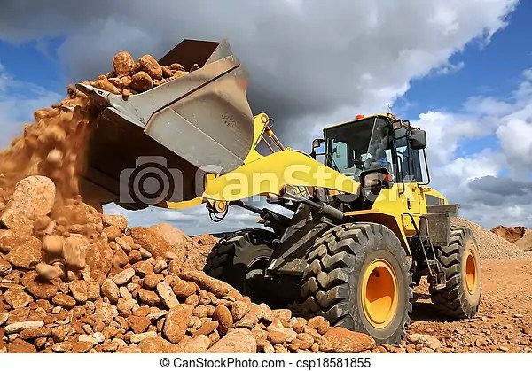 Front end loader tipping stone. Front end loader dumping stone and sand in a mining quarry.