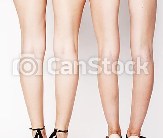 Legs Of Young Women Pair Of Butts In Jeans Shorts