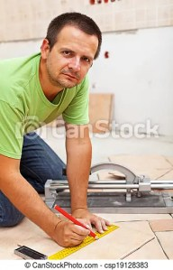 Man marking and cutting ceramic floor tiles   kneeling near a cutter     Man marking and cutting ceramic floor tiles   csp19128383