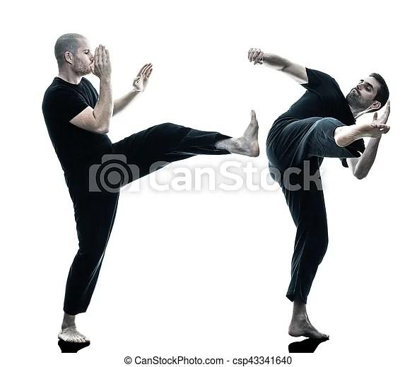 Two caucasian men krav maga fighters fighting isolated silhouette on white background.