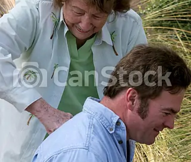 Mother Gives Backrub To Son Csp0230682