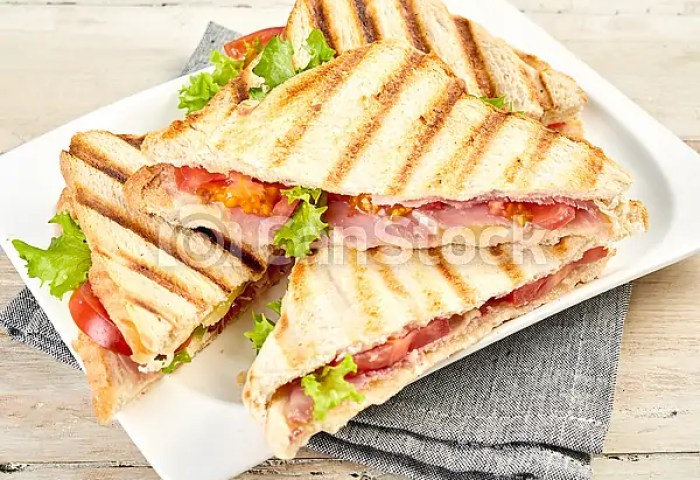 Plated Of Toasted Or Grilled Ham Sandwiches On Crispy White Bread