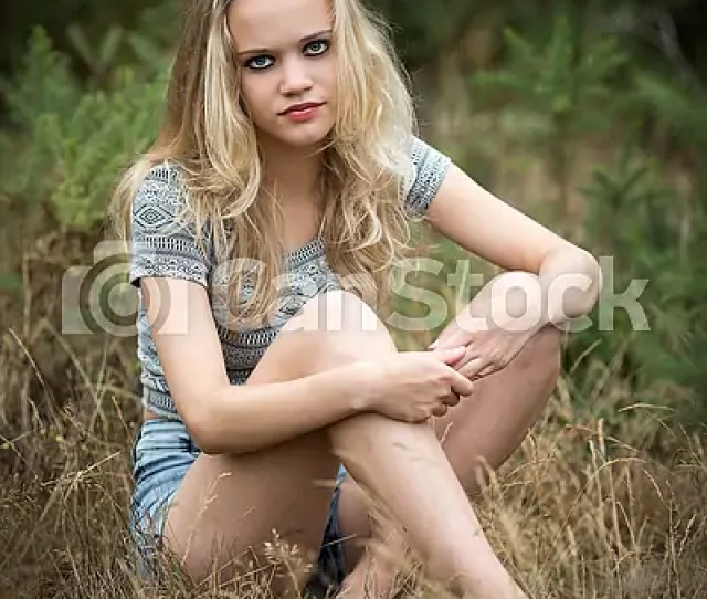 Pretty Blond Teenager Sitting In The Grass Csp35440096