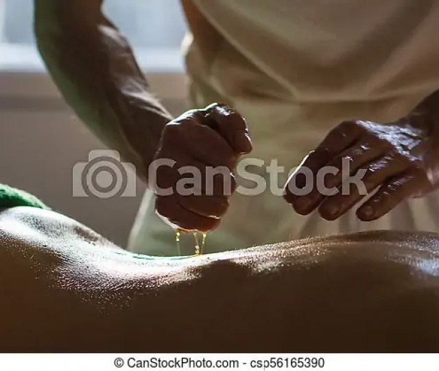 Professional Masseur Doing Deep Tissue Oiled Massage To A Girl At Ayurveda Massage Session Csp