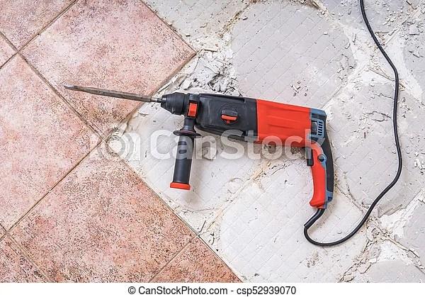 https www canstockphoto com removing old tiles jackhammer 52939070 html