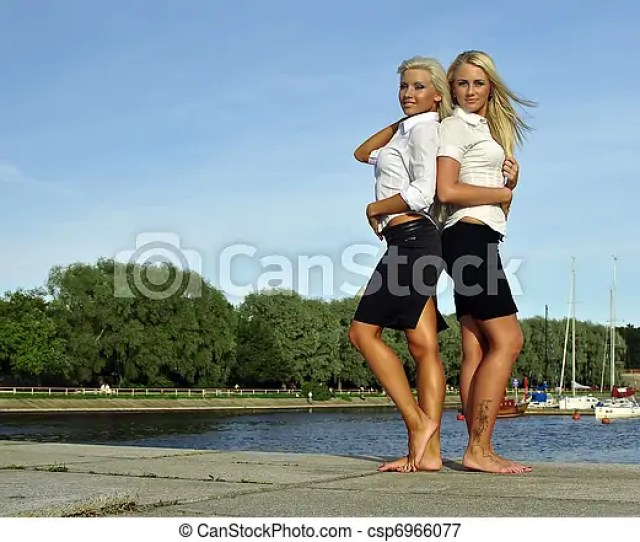 Two Barefoot Girls On River Bank Csp6966077