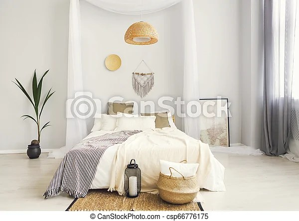White And Beige Bedroom In Boho Style With Macrame On The Wall Canstock