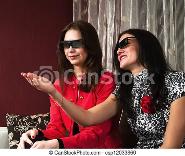 Young Beautiful Women At Home Watching A 3d Movie Csp12033860