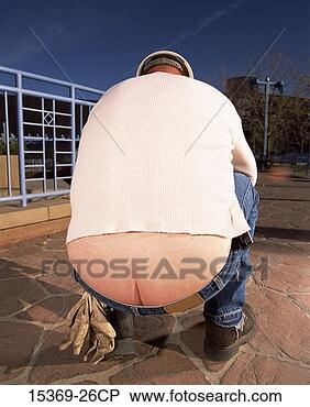 Stock Photo - rear view of construction  worker bending  over revealing  his butt crack.  fotosearch - search  stock photos,  pictures, images,  and photo clipart