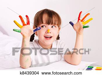 Stock Photo - girl painting with watercolor. Fotosearch - Search Stock Images, Mural Photographs, Pictures, and Clipart Photos