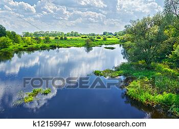 Picture - Spring landscape with Narew river and clouds on the sky. Fotosearch - Search Stock Photography, Photos, Prints, Images, and Photo Clipart