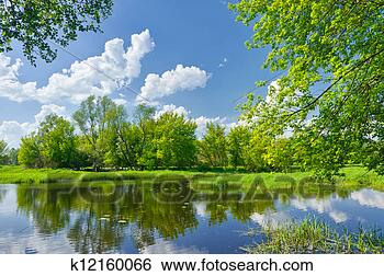 Stock Image - Spring landscape with Narew river and clouds on the blue sky. Fotosearch - Search Stock Photography, Poster Photos, Pictures, and Photo Clip Art