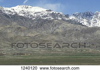 Stock Photography - snow covered mountains  100 km north of  kabul, afghanistan.  fotosearch - search  stock photos,  pictures, images,  and photo clipart