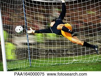 Stock Image - goal keeper reaching  for soccer ball.  fotosearch - search  stock photos,  pictures, images,  and photo clipart