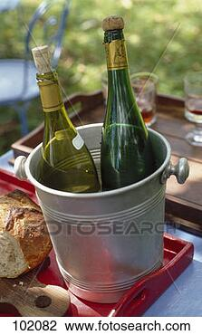 Stock Photo - bottles of wine  in a bucket. fotosearch  - search stock  photos, pictures,  images, and photo  clipart