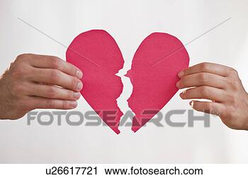 Stock Photography - Two hands holding broken paper heart. Fotosearch - Search Stock Photos, Pictures, Prints, Images, and Photo Clip Art