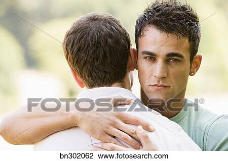 Stock Photo - gay couple hugging.  fotosearch - search  stock photos,  pictures, wall  murals, images,  and photo clipart