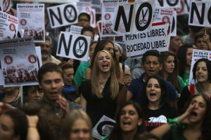 Students shout slogans during a protest on the final day of a three-day nationwide student strike against rising fees and educational cuts in Madrid