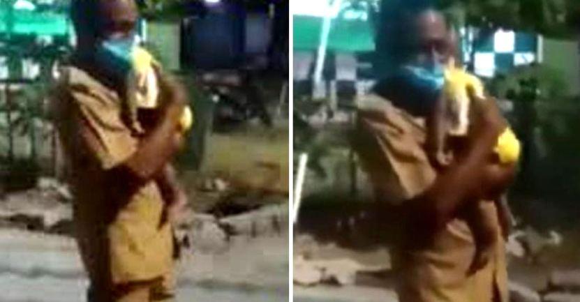hombre carga a bebe tras accidente - Guardia cargó y calmó a bebé de 7 meses tras el accidente de sus padres. Solo quería tranquilizarla