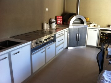 Alfresco metal frame doors with pizza oven corian top in atwell
