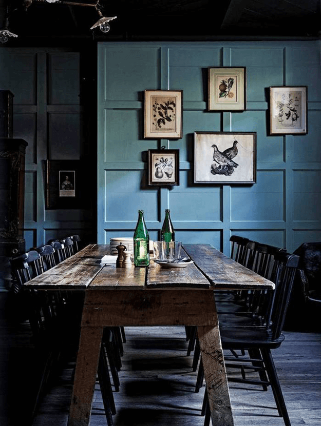 dark dining room with slate blue paneled walls