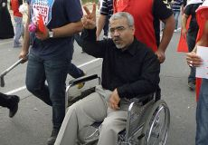 Abduljalil al-Singace taking part in March of royal court in Riffa