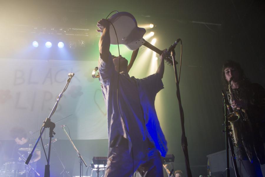 Cole Alexander raises his guitar to the punk-rock heavens.