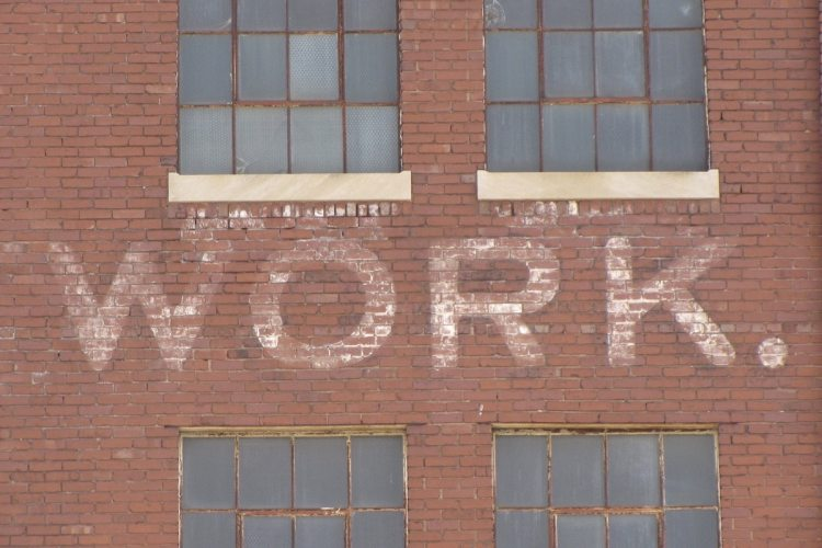 "A brick building with the word ""work"" on the side."