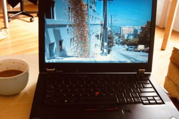 Image of a laptop and cup of coffee.