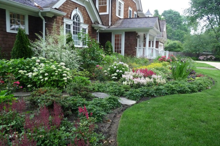 A large suburban house with professional landscaping