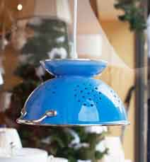 A pendant light made from a colander