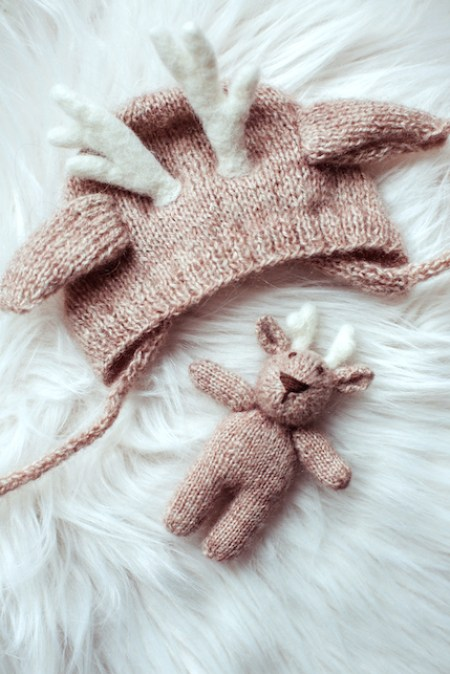 Beautiful cute baby's hat and toy close-up