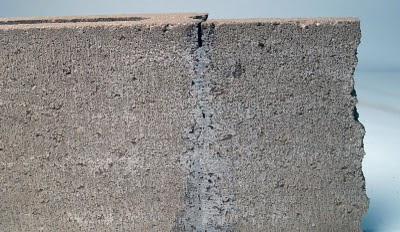Repairing vertical cracks in concrete structures with Roadware 10 Minute Concrete Mender™.