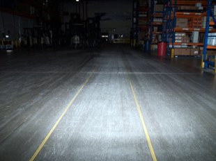 Warehouse floor with safety yellow lines made from Concrete Mender™ Safety Yellow Color.