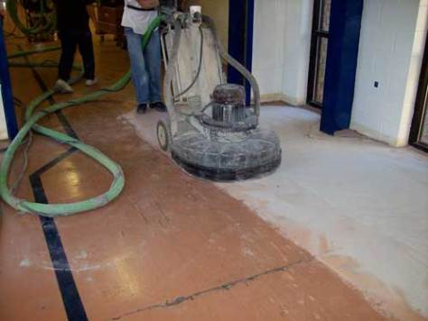 Polishing concrete floor to be repaired with Concrete Mender™.