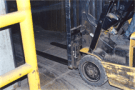 Forklift rolling over freezer warehouse threshold repaired with Concrete Mender™.