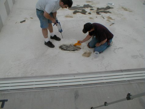 Roadware 10 Minute Concrete Mender mixed with sand is troweled into place.