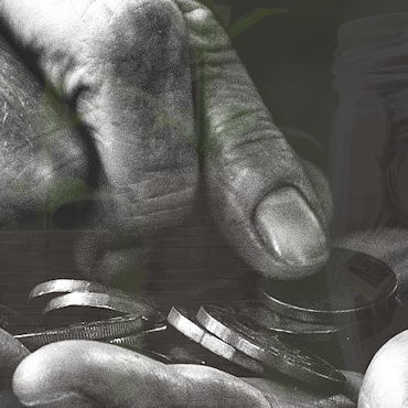 Two old hands holding and grasping pennies in black and white. Faintly seen a shoot and jar of pennies behind.