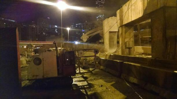 Pier cap sawn in tight quarters, during short, night-time closures